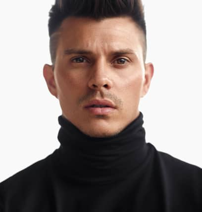 Kenny Braasch modeling in a turtleneck