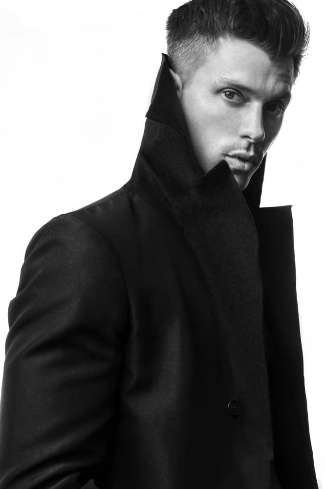 Kenny Braasch modeling a peacoat in black and white.