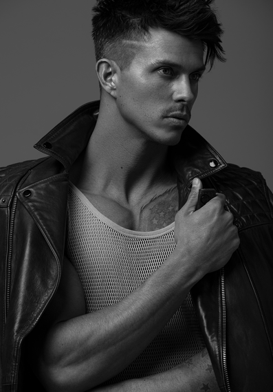 Kenny Braasch modeling a mesh tank top and leather jacket in black and white.